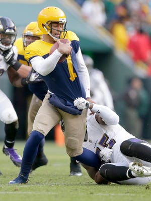 Packers quarterback Brett Hundley is sacked by Ravens linebacker Terrell Suggs. Hundley was sacked six times, threw three interceptions and lost a fumble Sunday.