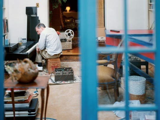 "The cover image from ""Musik"" capturing Eggleston in the early-'90s at the controls of his Korg synthesizer."