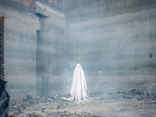 """This image released by A24 shows a scene from the film, """"A Ghost Story."""""""