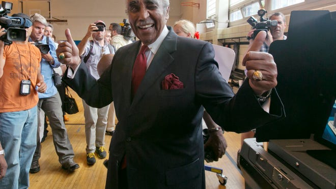 Congressman Charles Rangel, D-N.Y., flashes a thumbs-up after voting in the congressional primaries, Tuesday, June 24, 2014, in New York. Rangel, 84, one of the most recognizable members of the Congressional Black Caucus, faces multiple challengers in his primary as he aims for a 23rd term representing demographically shifting areas of New York City. Rangel's top challenger is state Sen. Adriano Espaillat, who would become the first Dominican-born member of Congress. (AP Photo/Richard Drew)