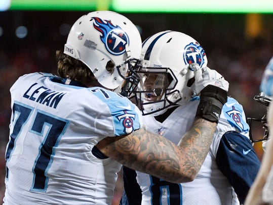 FILE -- In this Saturday, Jan. 6, 2018, file photo, Tennessee Titans offensive tackle Taylor Lewan (77) congratulates quarterback Marcus Mariota (8) after Mariota scored a touchdown against the Kansas City Chiefs during an NFL wild-card playoff football game in Kansas City, Mo. Lewan said Mariota has made big plays two weeks in a row to fire up the Titans, including a stiff-arm while running to a big first down to clinch Tennessee's playoff berth in the regular-season finale. (AP Photo/Ed Zurga, File)