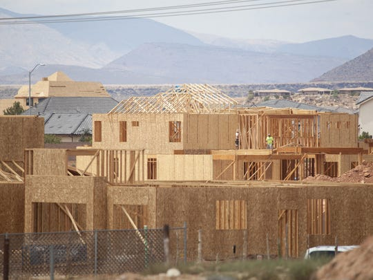 Construction crews work on homes in Little Valley in