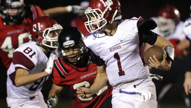 De Pere's Cole Runge (1) carries the ball during Friday's game at Sheboygan South.
