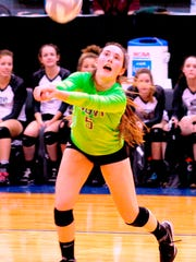 Novi libero Claire Pinkerton makes the dig in Friday's three-set semifinal win over Fenton.