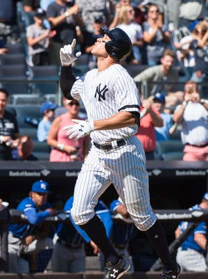 Aaron Judge gestures after he hits his 49th home run of the season.