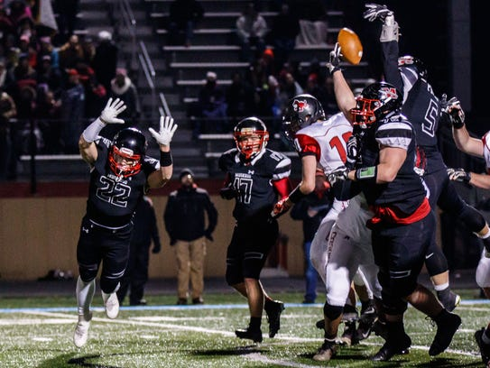 Muskego linebacker Addison Price (5) blocks a PAT attempt