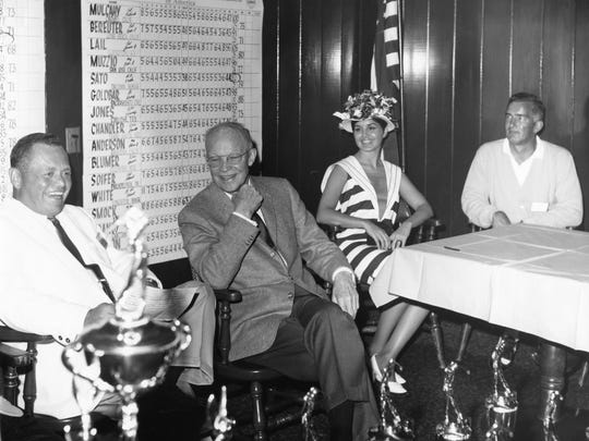 Pres. Eisenhower with trophies in Bermuda Dunes Country Club.