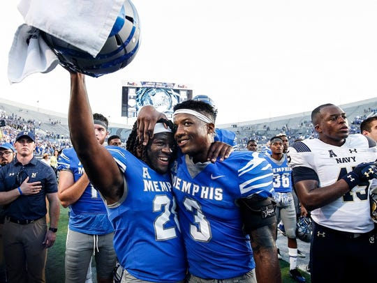 University of Memphis teammates Doroland Dorceus, left,