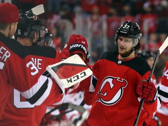 New Jersey Devils center Pavel Zacha (37) celebrates