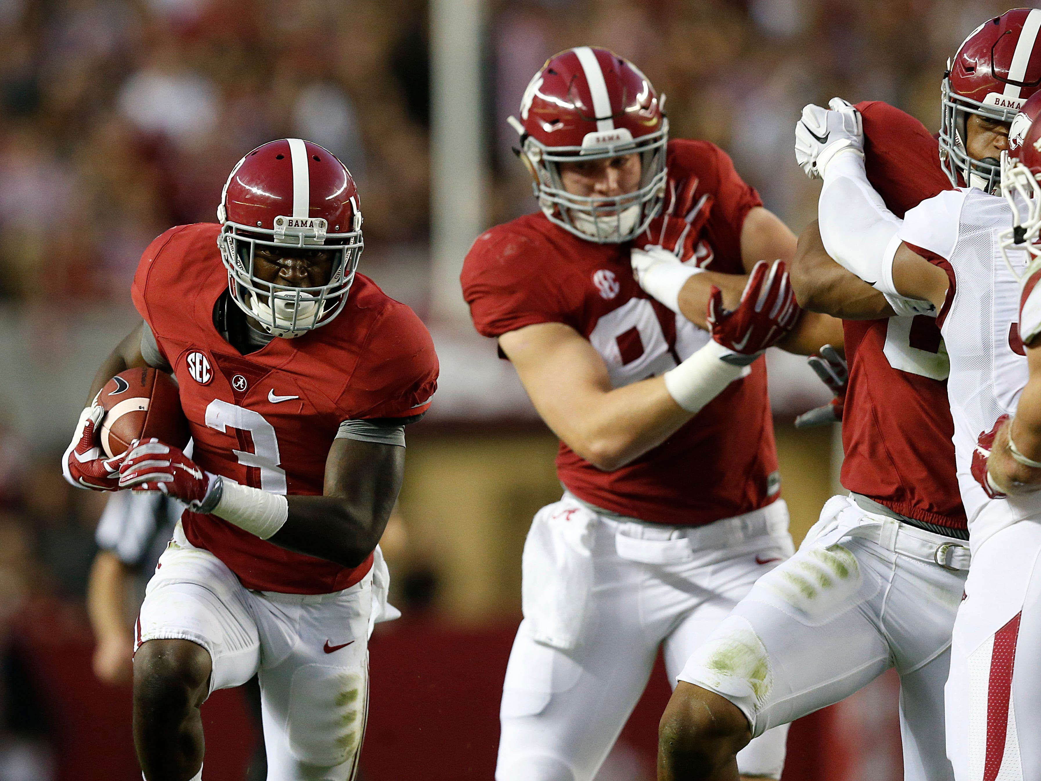 Alabama wide receiver Calvin Ridley (3) runs the ball against Arkansas in the first half of an NCAA college football game, Saturday, Oct. 10, 2015, in Tuscaloosa, Ala. (AP Photo/Brynn Anderson)