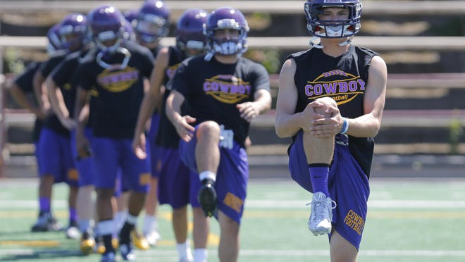 The Salinas High School football team practices Friday at The Pit on campus.