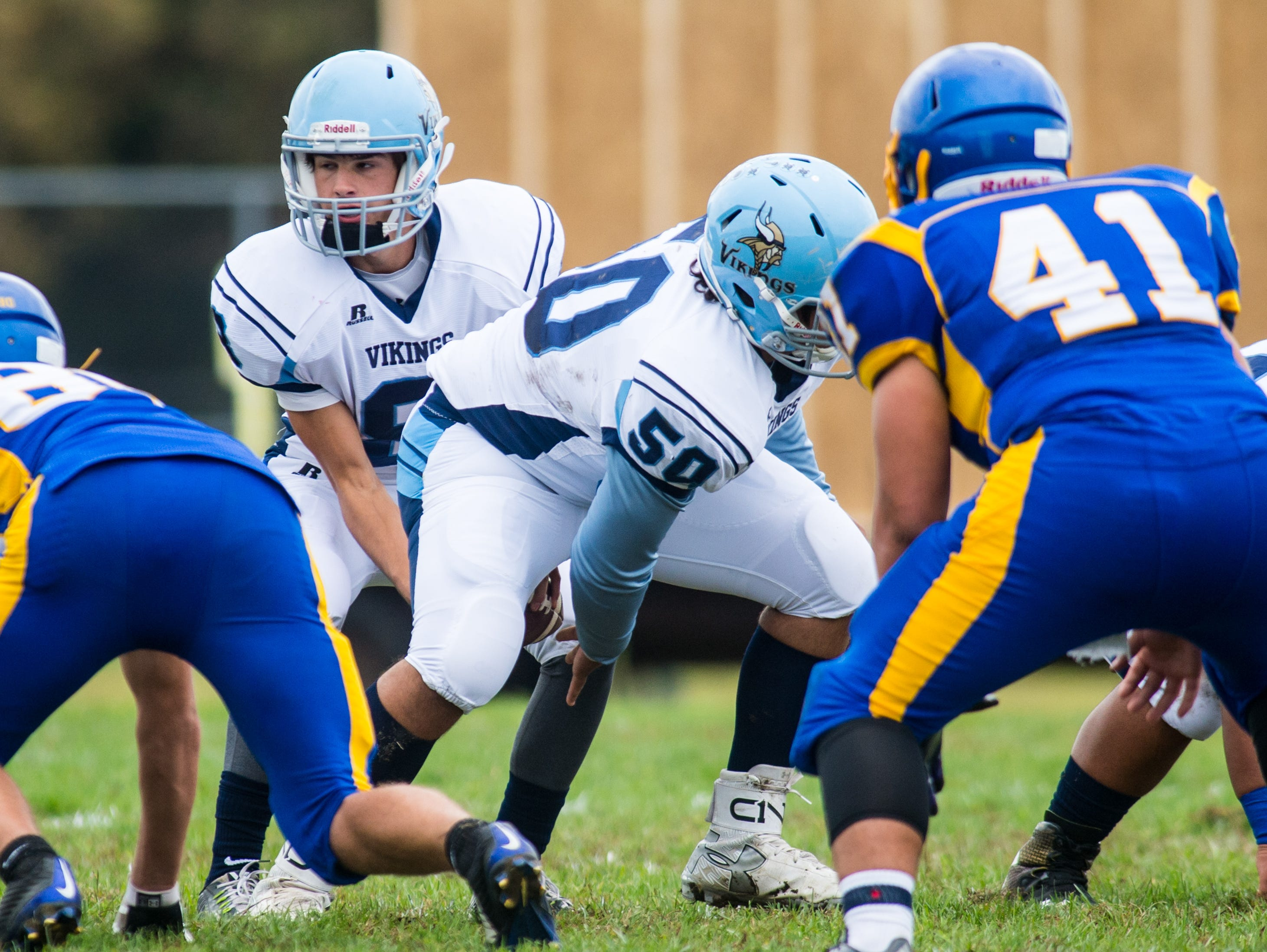Cape Henlopen center Julian Medina (50) snaps the ball to quarterback Dillon Adams (8) against Sussex Central in Georgetown on Saturday, October 10th.