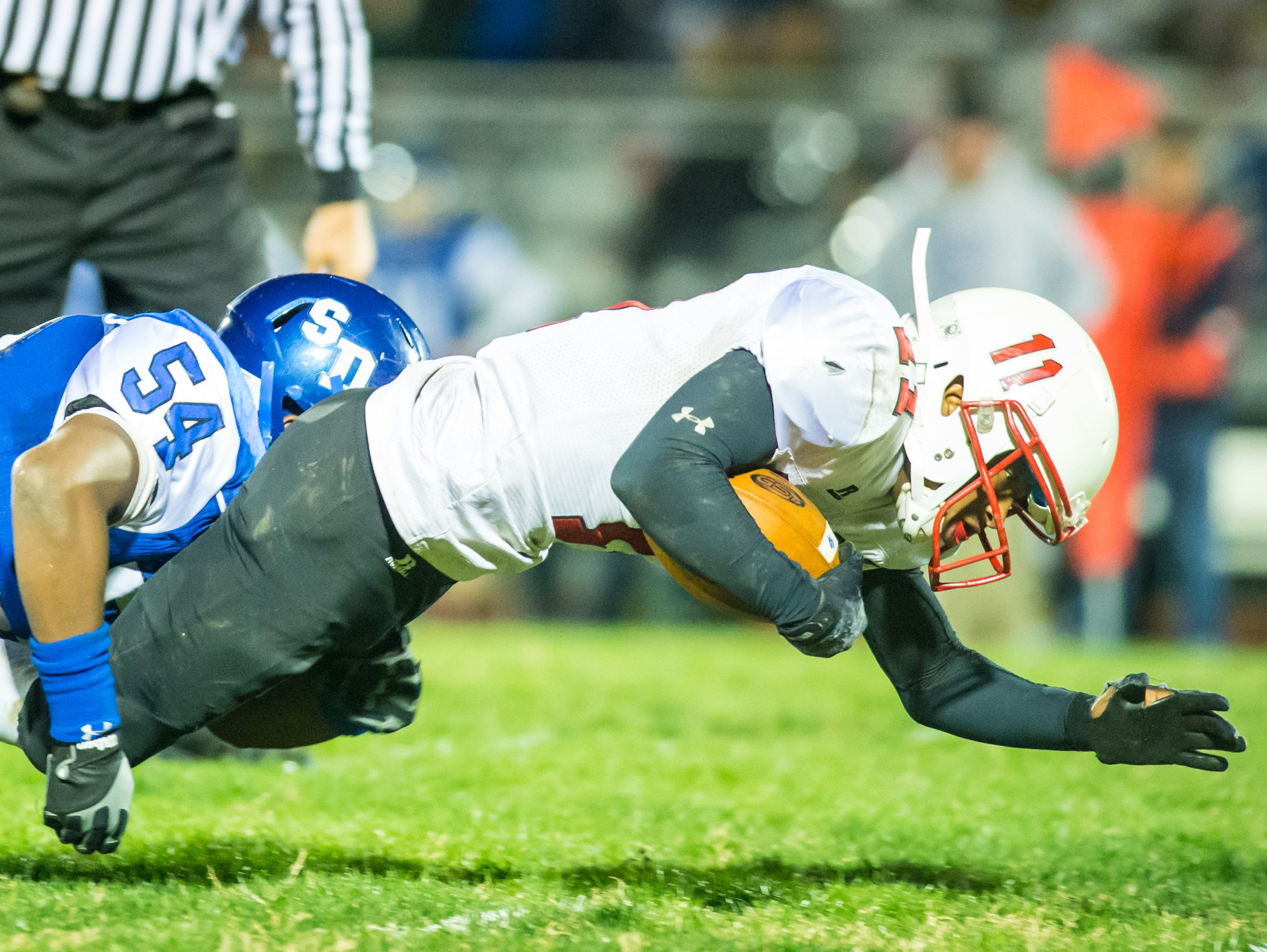 James M Bennett running back Ty King (11) is stopped short of the goal line by Stephen Decatur linebacker Ernest Shockley (54) on Friday night at Seahawk Stadium in Berlin.
