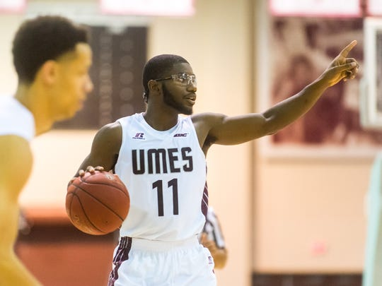 UMES guard Ahmad Frost (11) directs traffic against Fairfield in 2015 at the Hytche Center in Princess Anne.