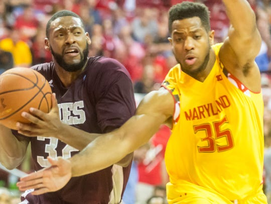 Maryland forward Damonte Dodd (35) guards UMES forward