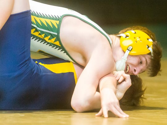 Indian River's Dylan Ely (120-lb) squares off with