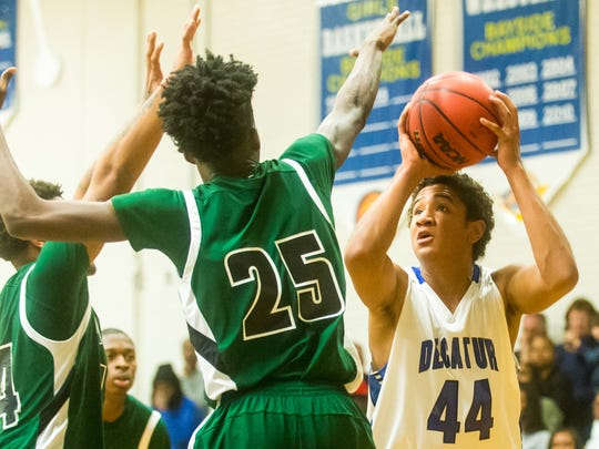Stephen Decatur center Keve Aluma (44) takes a shot against Parkside on Thursday, January 14 in the Bird Cage at Stephen Decatur High School.