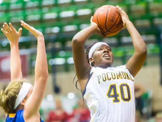Pocomoke forward Dynaisha Christian (40) takes a shot against Walkersville on Tuesday, December 29th at the Wicomico Youth and Civic Center as part of the Governor's Challenge.