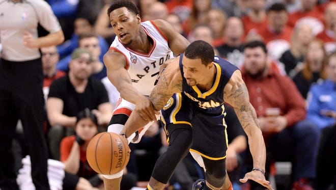 Toronto Raptors' Kyle Lowry (7) tries to block Indiana Pacers' George Hill (3) as he chases the ball Toronto Raptors' DeMar DeRozan (10) picks up an offensive foul against Indiana Pacers' Paul George (13) during the second half in Game 1 in the first round of the  NBA basketball playoffs in Toronto, Saturday, April 16, 2016.