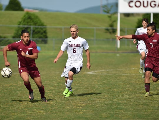 Stuarts Draft's Eric Custard, center, chases after