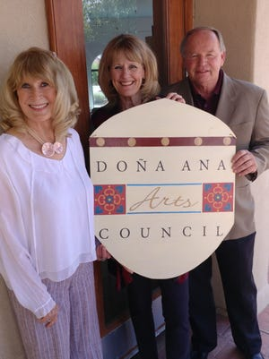 Doña Ana Arts Council members, from left, Barbara Reasoner, Kathleen Albers and Scott Breckner stand together.