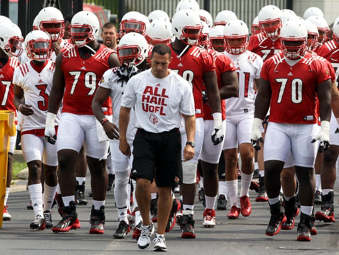 A large group of Cardinals make their way to the practice field for the first day of football practice. August 5, 2014