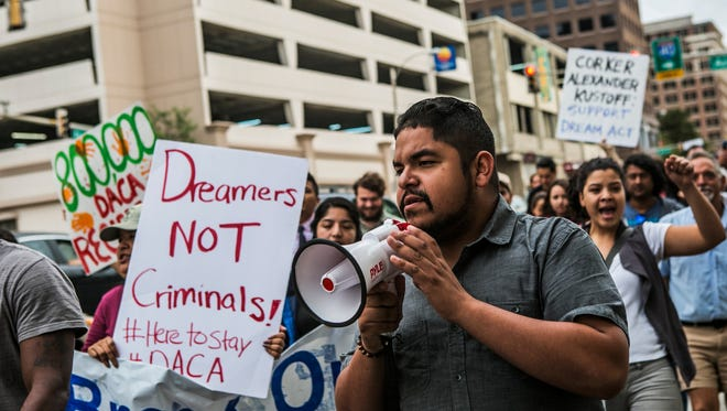 "September 5, 2017 - Activist Jose Salazar speaks as he leads marchers from the Jefferson Davis Confederate statue to the Clifford Davis/Odell Horton Federal Building during a Deferred Action for Childhood Arrivals (DACA) march called ""Here to Stand, Here to Stay"" on Tuesday. The event was held after President Donald Trump's decision to rescind the DACA program. DACA was created in 2012 by President Obama through executive order. It grants two-year renewable work permits to young people who were brought to this country illegally or on visas that later expired. Applicants had to pass a criminal background check and meet several other requirements. It does not grant citizenship or permanent legal status, and Trump's administration has the power to end it with the stroke of a pen."