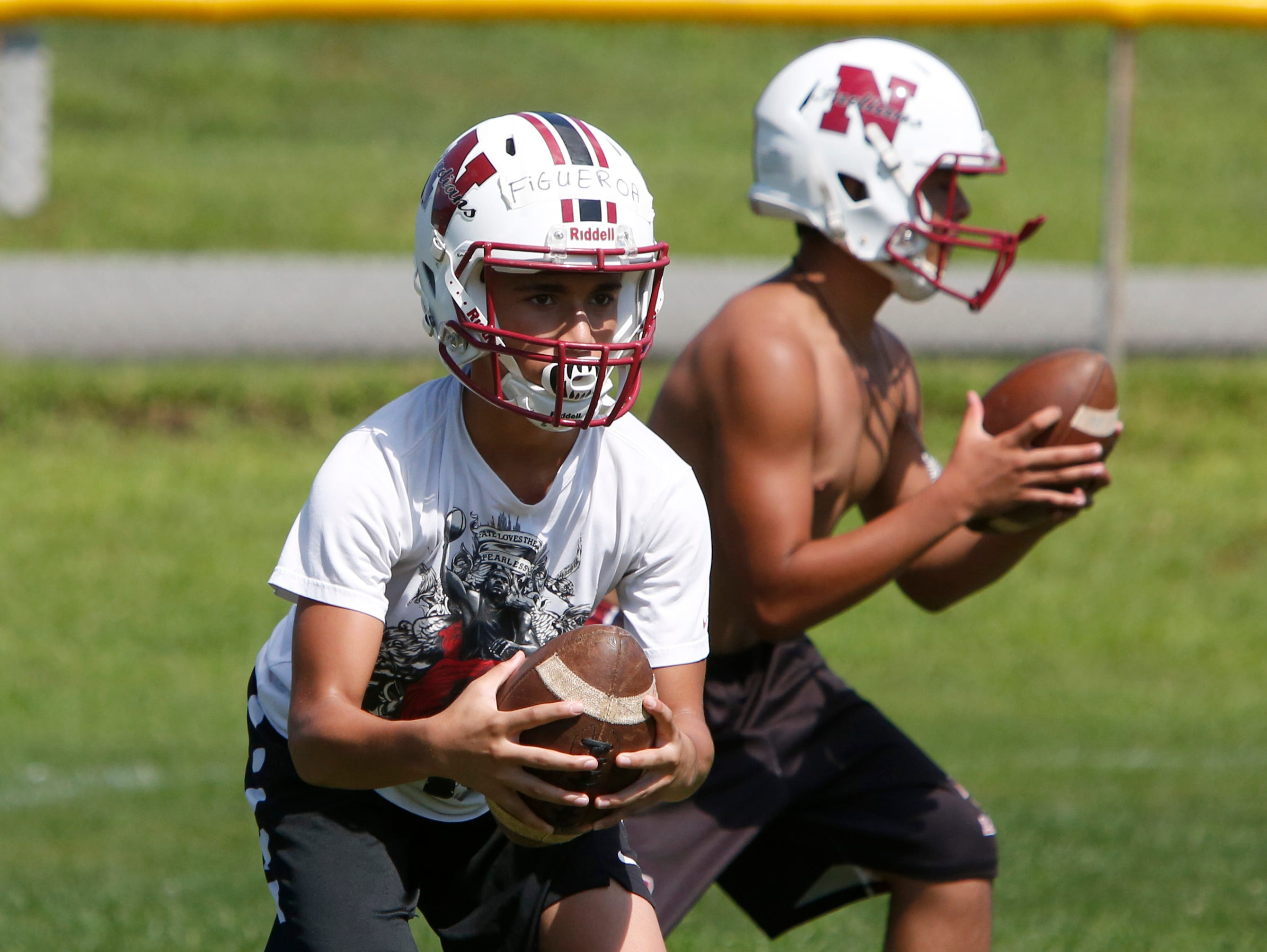 Nyack High School players work on passing during the first day of football practice Aug. 15, 2016 at Nyack Middle School.
