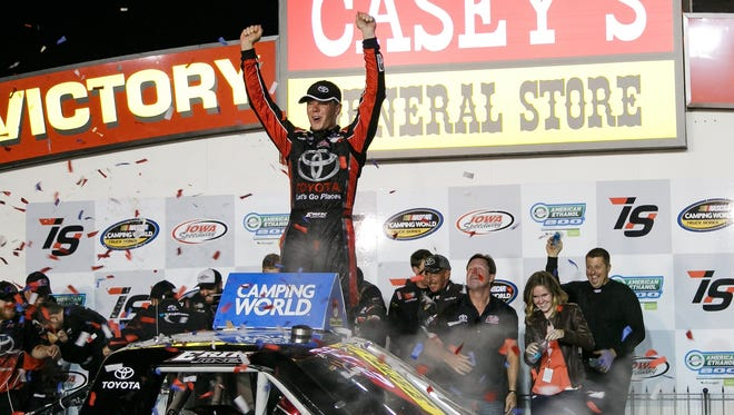 Erik Jones climbs out of his truck in victory lane after winning the Nascar Camping World Truck Series American Ethanol 200 at the Iowa Speedway in Newton on Friday, June 19, 2015.
