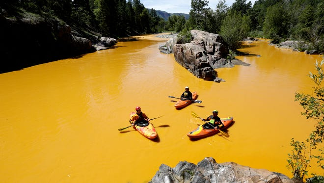 Kayakers paddled on the Animas River near Durango, Colo.,  Aug. 6, 2015, in water tainted by a  1-million-gallon mine waste spill inadvertently caused by the U.S. Environmental Protection Agency.