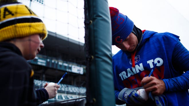 The Iowa Cubs Albert Almora Jr. signs an autograph during an open workout at Principal Park on Wednesday, April 6, 2016 in Des Moines.