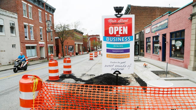 Orange barrels due to ongoing construction Thursday, April 21, 2016, in the 1000 block of Main Street. Although an inconvenience, businesses in the area remain open.