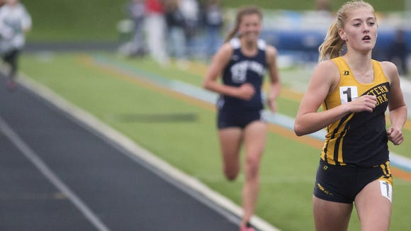 Eastern York's Maddie McLain, far right, leads West York's Bethany Weaver in the girls' 1,600 meter run. Athletes compete at the Dallastown Track and Field Invitational at Dallastown Area High School, Friday, April 29, 2016.