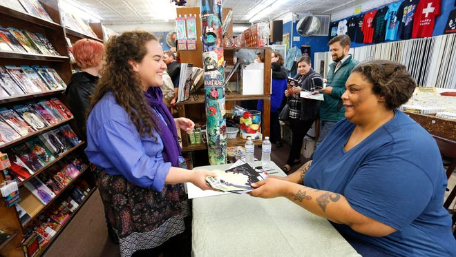 """Author Roxane Gay, right, signs copies of her comic book, """"Black Panther: World of Wakanda,"""" for Heather Murton in this 2016 photo at Von's Comics in West Lafayette."""