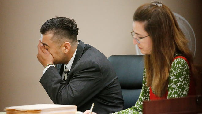 Ricardo Lorenzo Macias Jr. reacts Tuesday as one of several photos from the slaying scene were shown on the screen during the opening of day of his murder and aggravated robbery trial in the death of Jose Castañon in 2013. The trial is taking place in the 120th District Court with Judge Maria Salas-Mendoza presiding.