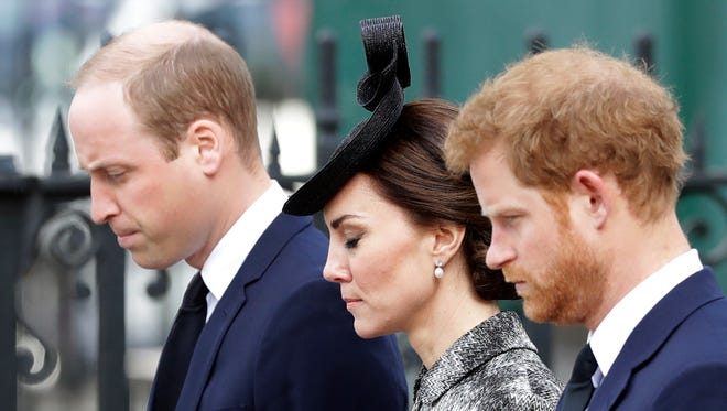 """From left, Britain's Prince William, Kate the Duchess of Cambridge and Prince Harry stand together after William laid a wreath after arriving for a """"Service of Hope"""" at Westminster Abbey, two weeks after the March 22 London terror attack, in London, Wednesday, April 5, 2017."""