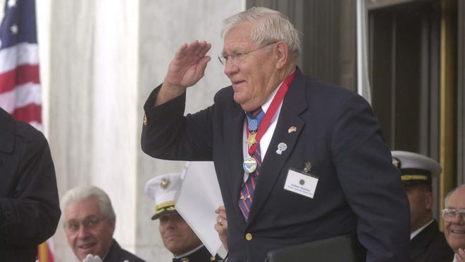 Arthur Jackson, Medal of Honor recipient, salutes the audience as he is introduced at the dedication of the Oregon Medal of Honor Memorial on Sept. 18, 2004, at the Oregon State Capitol in Salem.