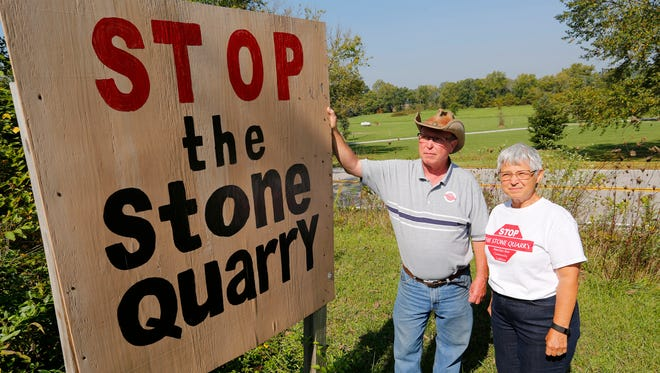Bill and Kay Miller, opponents of a proposed stone quarry, in their front yard Wednesday, September 20, 2017, near Americus. The Millers live across Old Indiana 25 from where the  entrance to the quarry would be located.