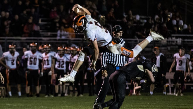 "Hanover quarterback Camden Mumma (5) hurdles over Biglerville's Hunter Getz (4) into the end zone for a personal foul during a football game between Biglerville and Hanover on Friday, Oct. 27, 2017 in Biglerville. ""I didn't know you couldn't hurdle,"" said Mumma following the game, who had never previously hurdled over another player."