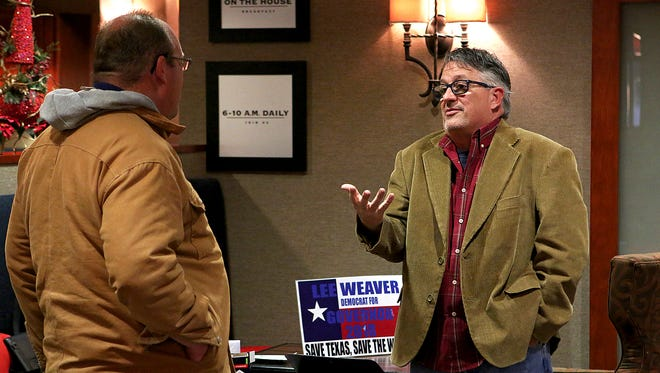 Former Wichitan Lee Weaver speaks to a prospective voter during a political fundraiser and meet-and-greet event at the Hampton Inn, 4217 Kemp Blvd., Friday evening. Weaver is aiming to run for Texas governor.