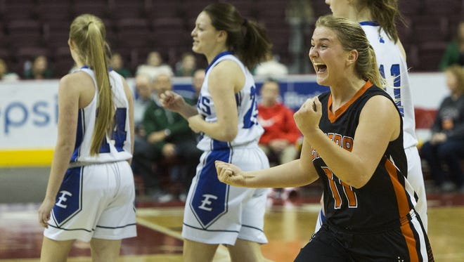 Central York's Nikson Valencik, right, celebrates as the game ends. Central York defeats Elizabethtown 48-37 in a District 3 Class 6A girls' basketball semifinal game at Giant Center in Derry Township, Monday, February 26, 2018.