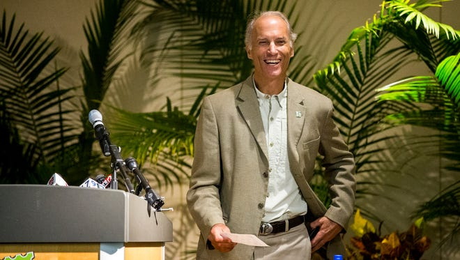 Thane Maynard, director of the Cincinnati Zoo & Botanical Garden, looks at a $10 million check from Harry and Linda Fath, which is part of their $50 million gift for the new $150 million capital campaign Thursday, June 7, 2018 in Avondale. Harry and Linda Fath's gift is the largest in the zoo's history.