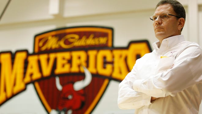 McCutcheon coach Jeff Knoy watches the action as the Mavericks take on Benton Central in the championship of the J&C Hoops Classic Saturday, November 22, 2014, at McCutcheon High School. Benton Central defeated McCutcheon 44-34 to win the J&C Hoops Classic championship.