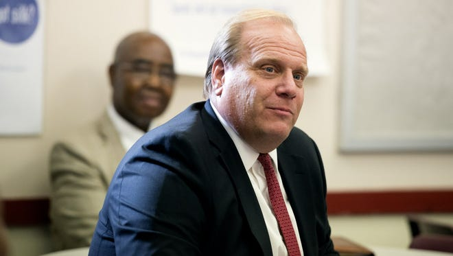 David Hespe, former New Jersey commissioner of education, with Paterson Superintendent Donnie Evans in the background.