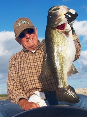 """Jim Porter of Palm Bay retired a couple years ago as a leading bass fishing guide on the infamous Farm 13 Stick Marsh south of Palm Bay. But he still catches more than his share on those occasions when he re-visits some of his old bass haunts in the 6,000-acre impoundment. This 8-pounder was among several in the 7- to 8-pound range that Porter and his lifelong friend Tommy Massey from South Carolina released during a recent trip. """"In one and a half hours we went through four dozen shiners and never had a bass under 3.5 pounds,"""" Porter said. """"It just goes to show that the Marsh is still kicking."""""""