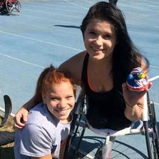 Jessica Larsen (right) is one of only two Arizona students to be named a U.S. Paralympics high-school All-American in track and field for 2014.