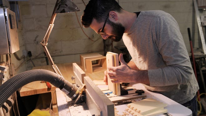 Kyle Huntoon has been handcrafting hundreds of items at Hunt & Noyer Woodworks, one of 30 business owners and vendors who will be at BUILD Bizarre, a holiday market of sorts that is part of Small Business Saturday, at the D:hive in Downtown Detroit.