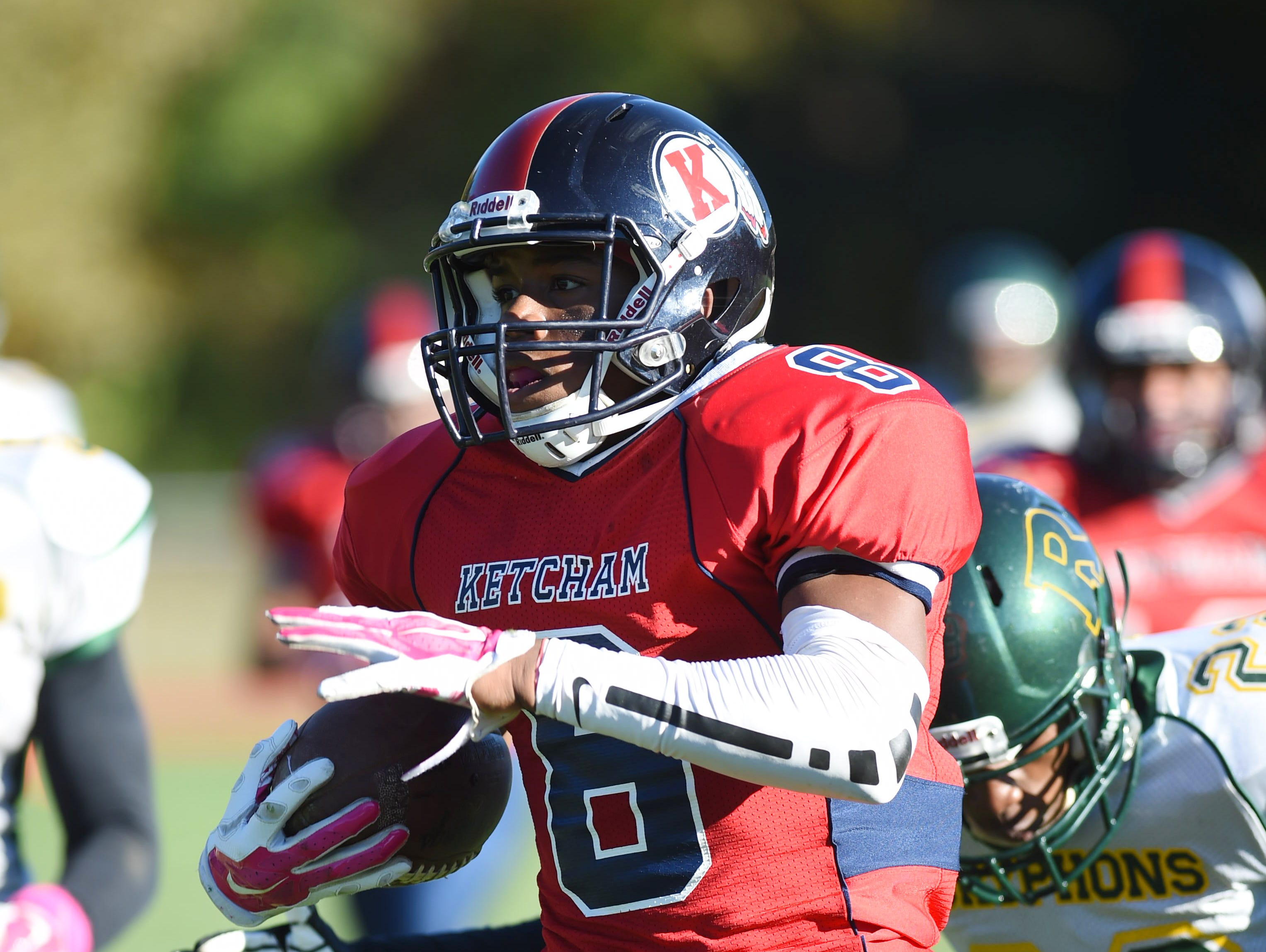 Ketcham's Daahir Woody attempts to outrun Ramapo's defense during Saturday's game in Wappingers Falls.