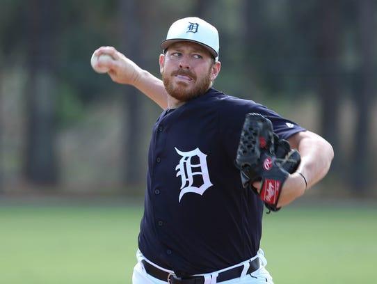 Detroit Tigers pitcher Johnny Barbato throws batting