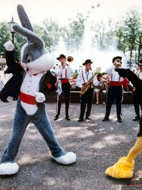 1993: Characters dance at Six Flags Great Adventure